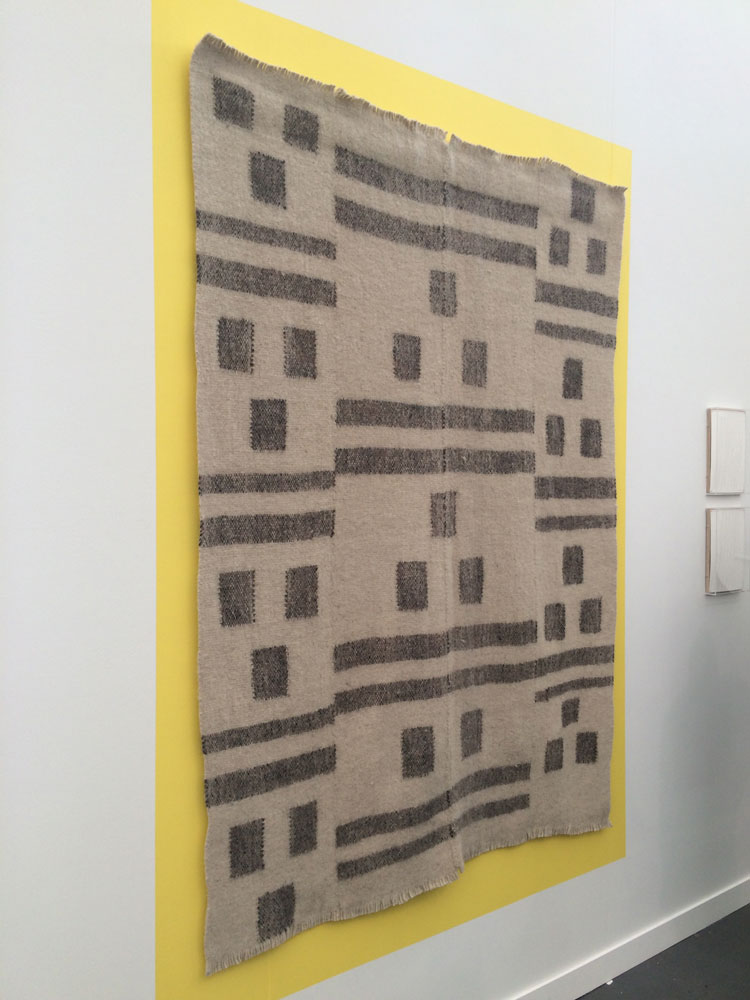 I loved the interplay between the raw weaving and the stark yellow backdrop in this installation by the young (very young…born in 1990) Belgian artist Kasper Bosmans in Marc Foxx's both.