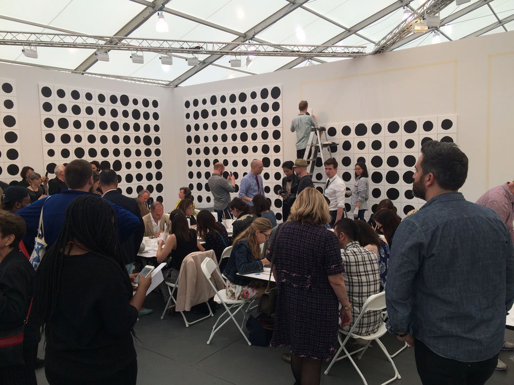 At Gavin Brown Enterprise's booth, artist Jonathan Horowitz set up a factory of sorts. Visitors to the booth were invited to paint an eight-inch black circle on a square white canvas, a task for which one would be paid $20. I did not partake given how crowded it was (although at the time I didn't know about the $20…may have changed my attitude!).