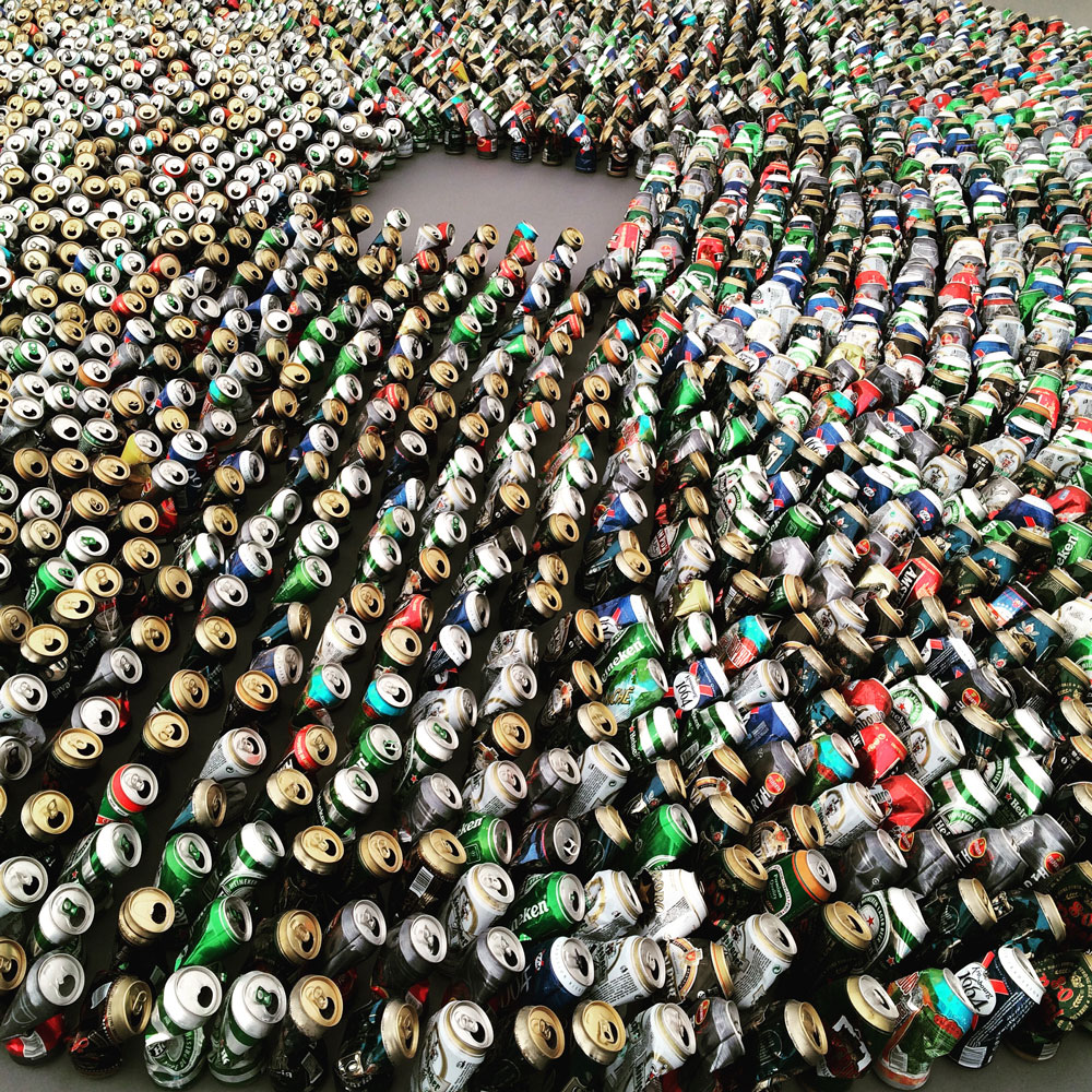 "Lehmann Maupin pulled out all the stops with this Kader Attia piece titled Halam Tawaaf (2008) which features almost 3,000 empty beer cans. The orientation of the cans in the circle inverts the traditional ""haram tawaaf,"" or the seven circumambulations required of Muslim pilgrims around the Kaaba in the center of Mecca. Rumor has it this work is headed to a major museum's permanent collection."