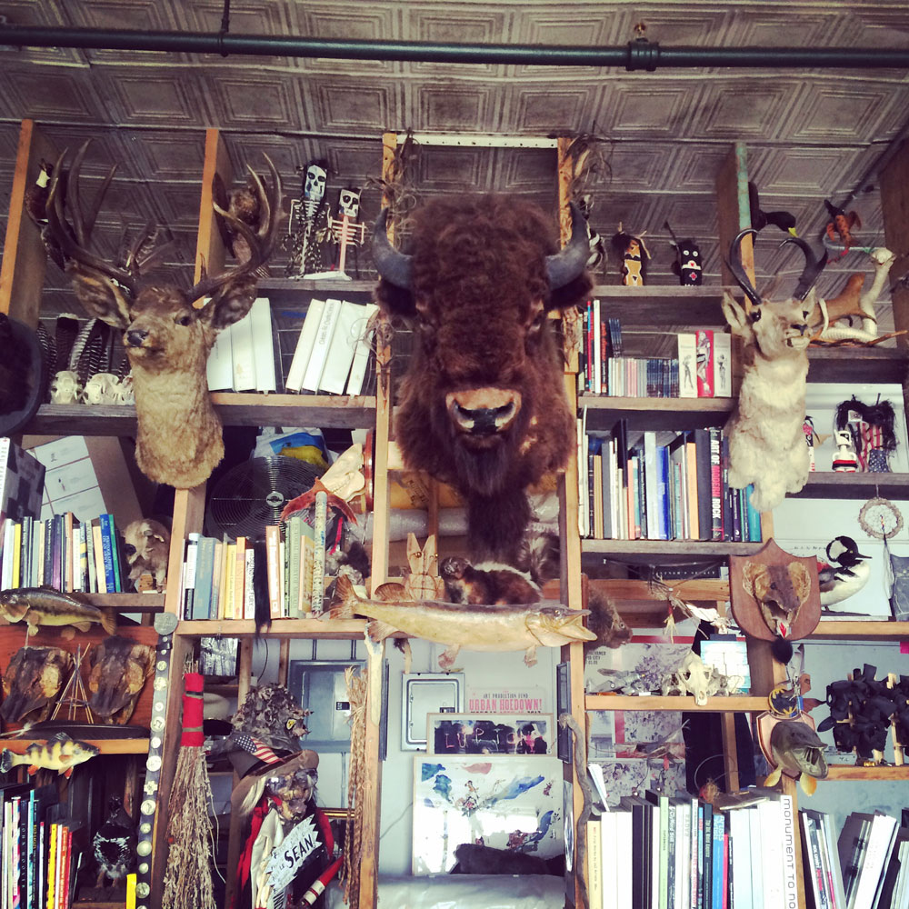 This inspiration bookshelf in Brad's studio was like a cabinet of curiosities. Part taxidermy display case, part library.
