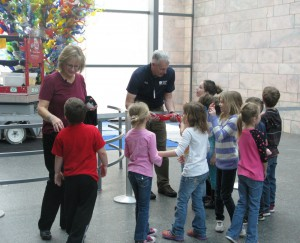 Council Bluffs 2nd graders get a surprise lesson on the care and cleaning of Museum artworks.